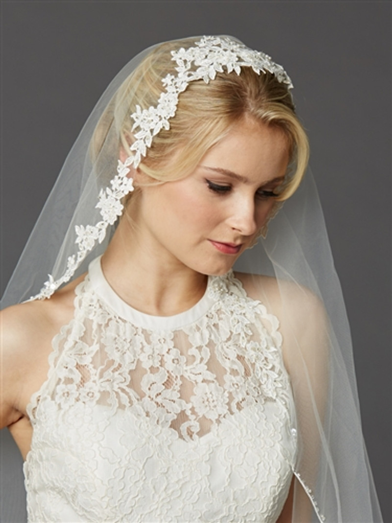 """Semi-Waltz Ballet Length Bridal Veil is 50"""" L x 60"""" w. Our One Layer veil has sculptured lace adorning the head and face and is both a veil and headpiece. The veil cascades into a pencil edge with dainty sequins & beads. Metal comb."""