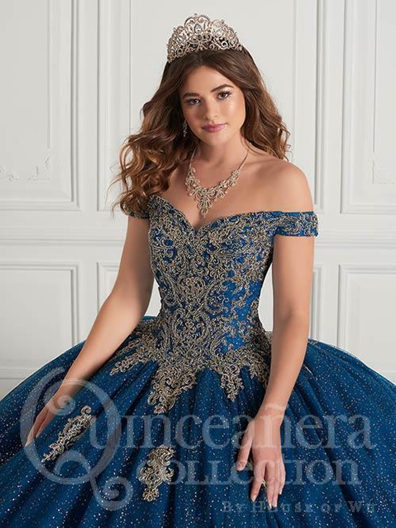 This quinceanera dress is available in Peacock/Gold.