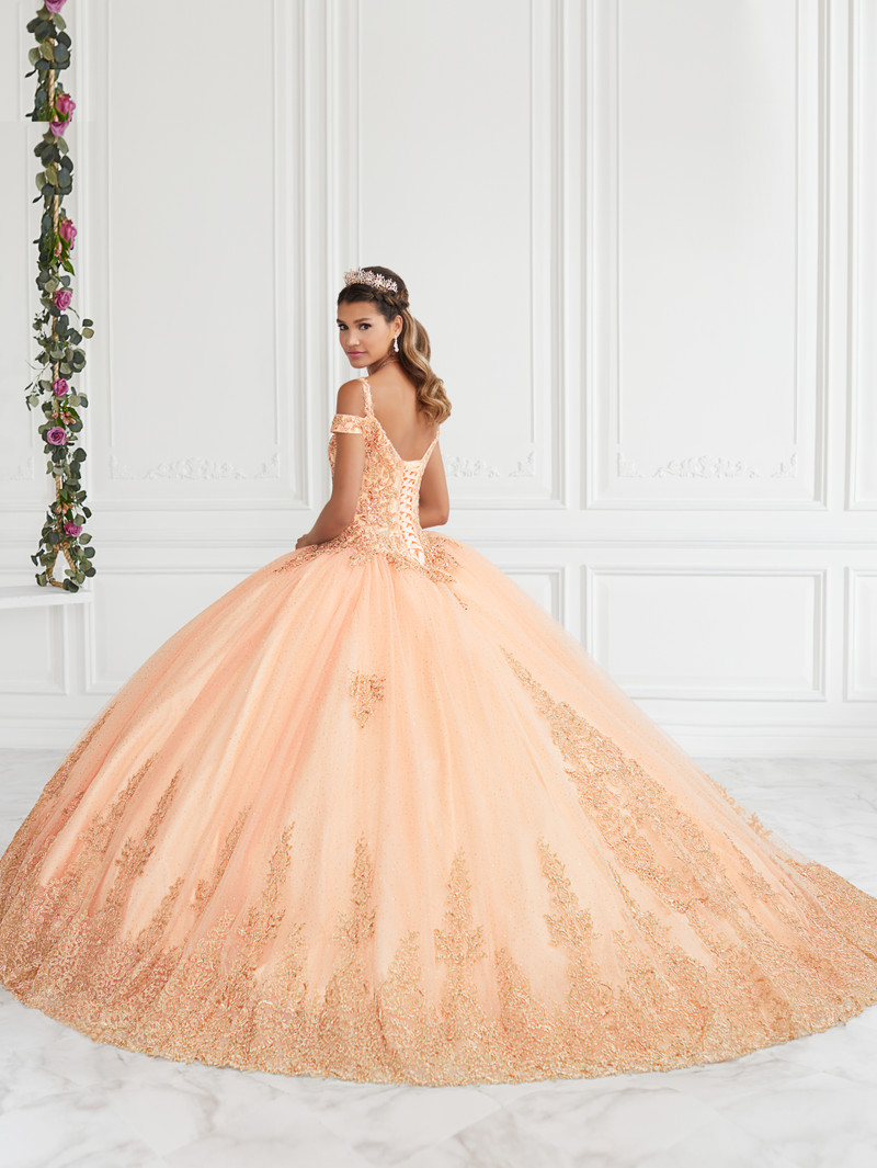 This quince dress features a small train and is available in Coral/Gold.