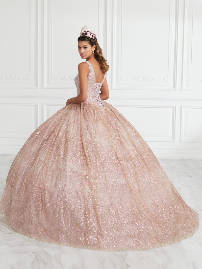 This quince dress features a small train and is available in dusty rose.