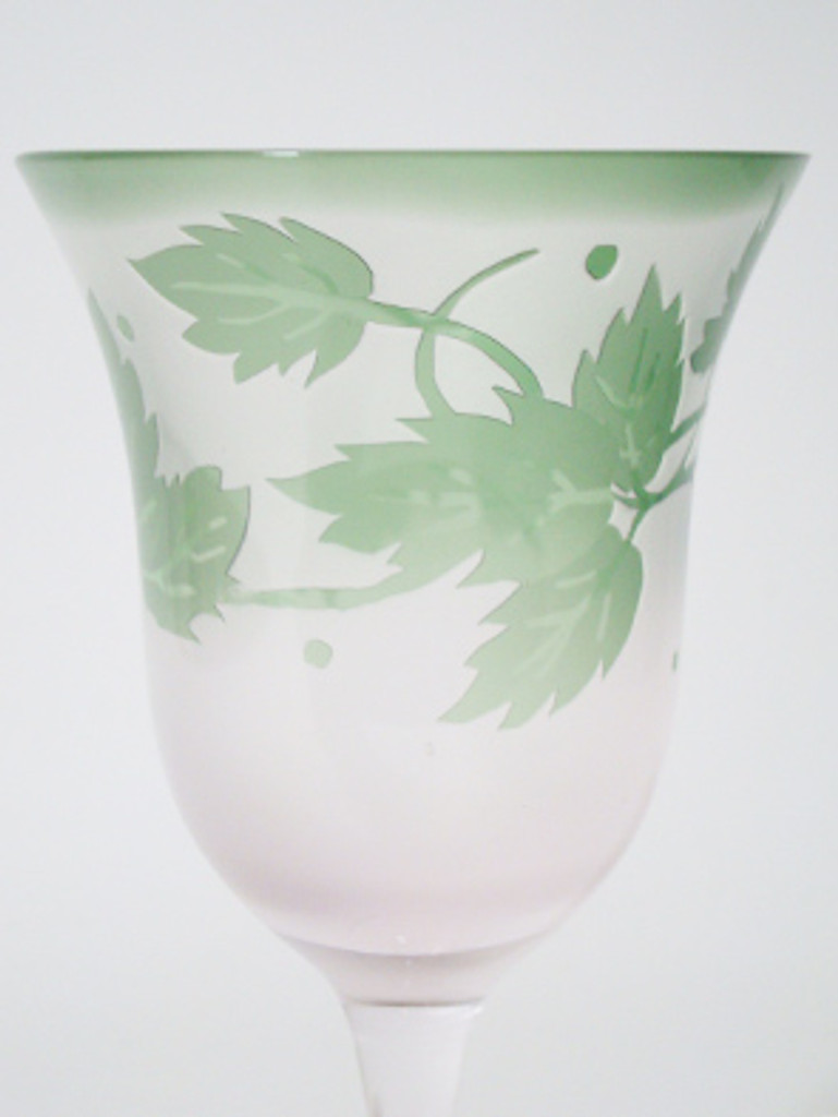 You might use this beautiful wineglass for your gorgeous meal. The color is pink and green.