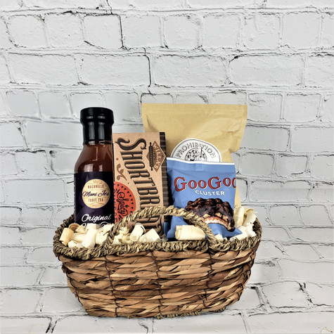 Perfect way to show someone you care! Unique seagrass gift tote filled with Mimi Jo's Fruit or Peach Tea, Willas Shortbread, Prohibition Popcorn and Goo Goo cluster.