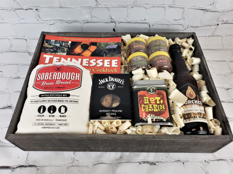 This beautiful wooden tray filled with Tennessee Hometown Cookbook, Soberdough Brew Bread, Jack Daniels Praline Pecans, J.M. Thomason Hot Chicken Mix, Torched Hot Sauce and Ellbee's Garlic four pack of seasoning.