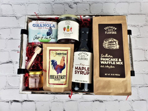 We have paired this delicious combination of items made in Tennessee including Southern pancake and waffle mix and pure maple syrup, Cumberland Valley coffee, Southern Cities hot pepper jelly, local honey and out of the blue granola. All packaged in a rustic white market tray.