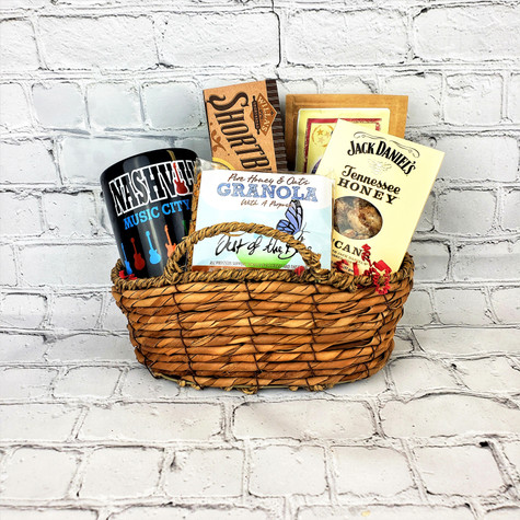 Just the right touch to say thank you or Welcome to Nashville. sea grass basket filled with Willa's shortbread, Tennessee Honey Praline Pecans, Out of the Blue Granola and Nashville coffee mug