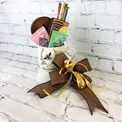 """""""Bee"""" Themed coffee mug filled with Honey Straws, Wildflower Tennessee Honey shortbread, Bee Mason Jar Coaster and Rose Earl Grey and Sweet Peppermint Tea Drops"""
