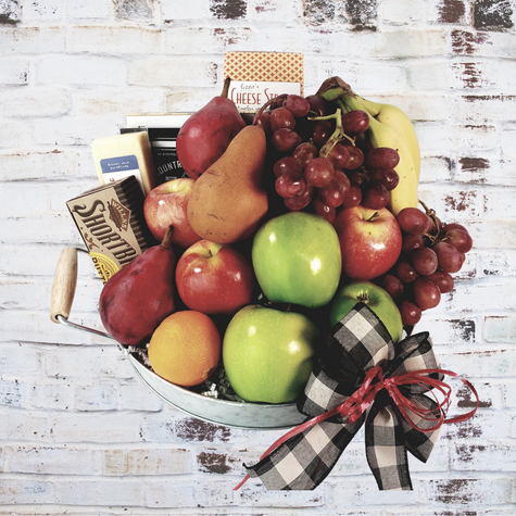 Stacked high with Fresh Seasonal Fruit and Gourmet treats such a gourmet cheese, cookies, cheese straws, Pecans and more