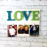 String art LOVE board with photo clips to add the photos of your choice