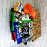 Deluxe Dog Basket includes Better Cities for Pets Insulated Cup, Notebook, Water bowl and Bandana, Iams Bandana, Iams Scoop, Dogs Rule Book, Wisdom Panel, Nutro Dry Dog Food, Iams Dry Dog Food, Dentistix treats, Greenies Treats, Cesar Treats, Nutro Crunchy Treats, (2) Two Packages of Nutro Wet Food and (2) Two Packages of Cesar Simply all Displayed in a decorative seagrass basket.     Shown with Whistle Fit Tracker