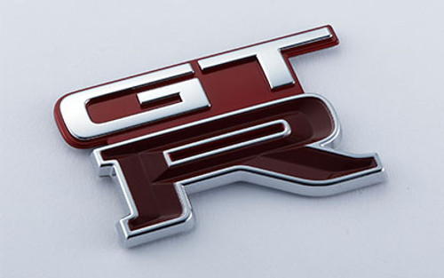 Nismo Heritage - Emblem - Rear, GT-R (AH3) - 84896-RHR21 (84896-05U01) - BNR32 Nissan Skyline GT-R