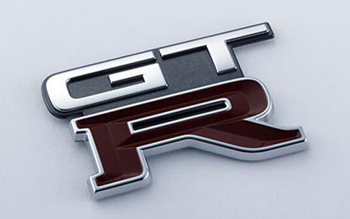 Nismo Heritage - Emblem - Rear, GT-R (KH2) - 84896-RHR23 (84896-05U03) - BNR32 Nissan Skyline GT-R