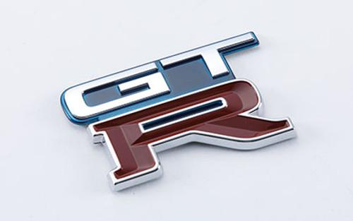 Nismo Heritage - Emblem - Rear, GT-R (TH1) - 84896-RHR24 (84896-05U04) - BNR32 Nissan Skyline GT-R