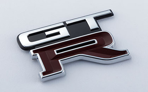 Nismo Heritage - Emblem - Rear, GT-R (732) - 84896-RHR25 (84896-05U05) - BNR32 Nissan Skyline GT-R