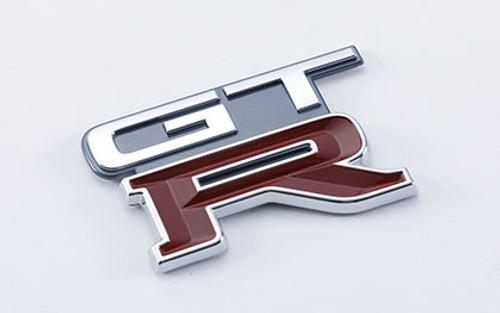 Nismo Heritage - Emblem - Rear, GT-R (BL0) - 84896-RHR26 (84896-05U07) - BNR32 Nissan Skyline GT-R