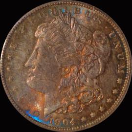 MS64 1904-O Morgan Silver Dollar Fantastic toning OBV and REV