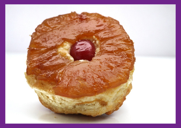 """The Pineapple, Banana & Rum Upside Down gourmet biscuit aka """"the lisa"""" adds a fresh twist of unique tropical flavor combinations to your typical pineapple upside down cake. So good, that you will be a converted biscuit lover!"""