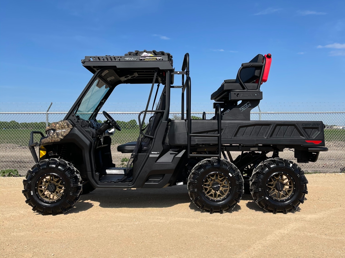 can-am-defender-6x6-long-bed-outfit-by-ranch-armor-with-metal-top-and-high-seat.jpg
