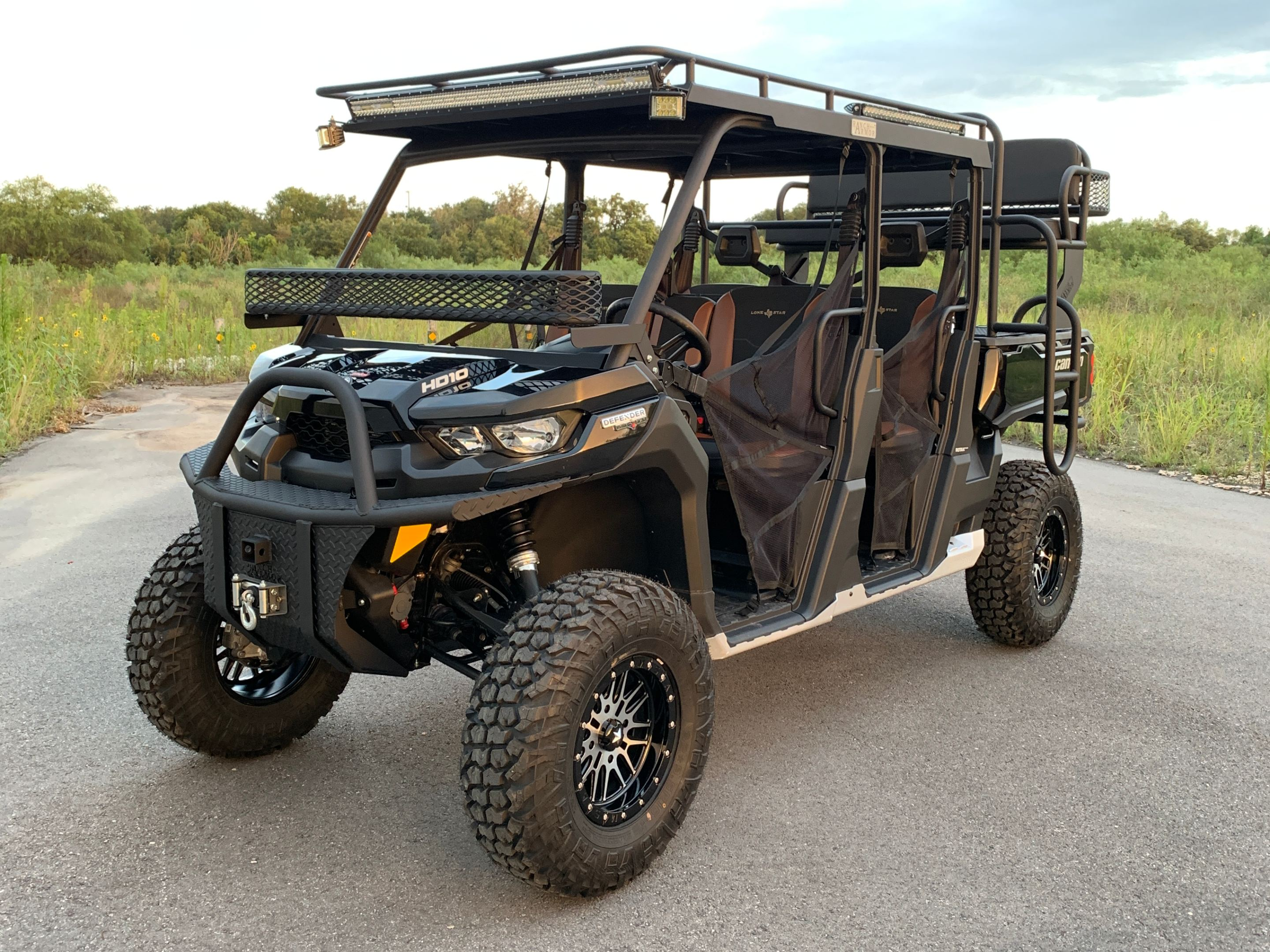 can-am-defender-outfit-by-ranch-armor-aluminum-roof-and-high-seat.jpg