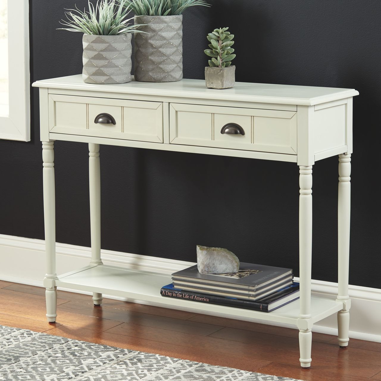 The Goverton White Console Sofa Table Available At Jaxco Furniture Serving Jacksonville Fl And Surrounding Areas