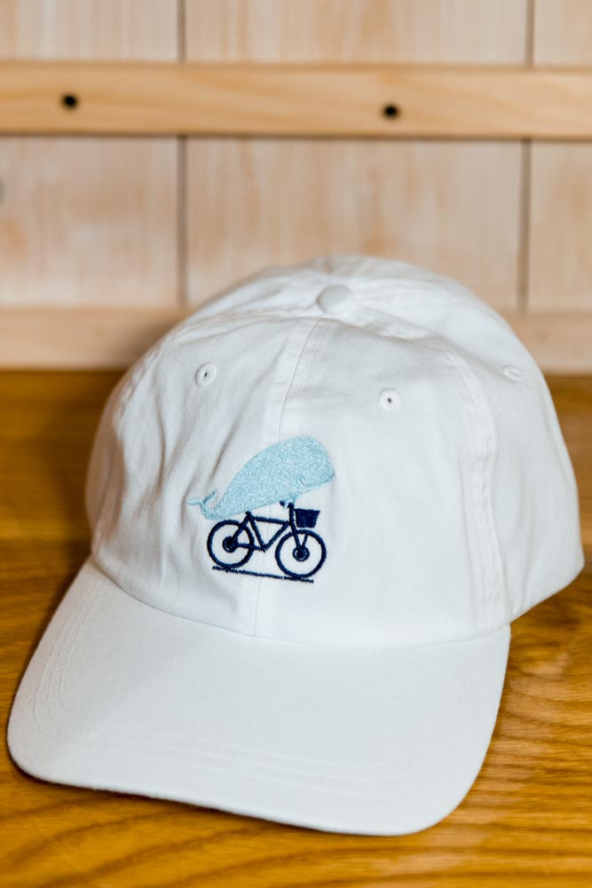 fdecc7ae7 TWGS EMBROIDERED WHALE-ON-THE-BIKE LOGO BASEBALL HAT - White