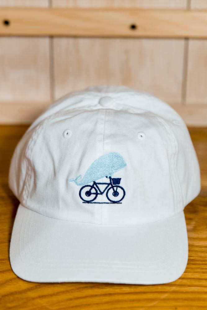 TWGS EMBROIDERED WHALE-ON-THE-BIKE LOGO BASEBALL HAT - White