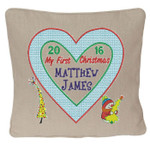 Oatmeal coloured Christmas Cushion with Beautiful Heart shaped Christmas Cushion design with tree and snowman motifs