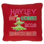 Red coloured personalised Christmas Cushion with a Beautiful Christmas tree design. My First Christmas in wooden block font
