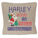 Oatmeal coloured Christmas Cushion cover with Stunning Personalised Christmas Cushion design featuring Santa with a Christmas tree and sack of presents, with beautiful wooden block font for 'my first christmas'