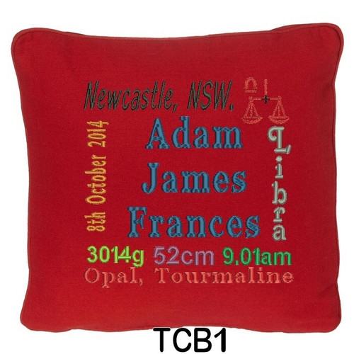 Red cushion cover personalised with baby's birth details and horoscope details and birthstone