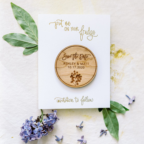Real wood save the date magnet with eucalyptus design by Paper Sushi