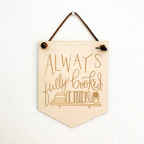 Always Fully Booked wood wall hanging by Paper Sushi