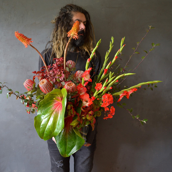 botany-ruby-red-luxe-man-holding-vase