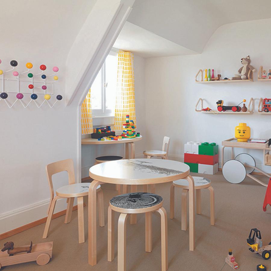 Alvar Aalto's E60 stool in kids room.