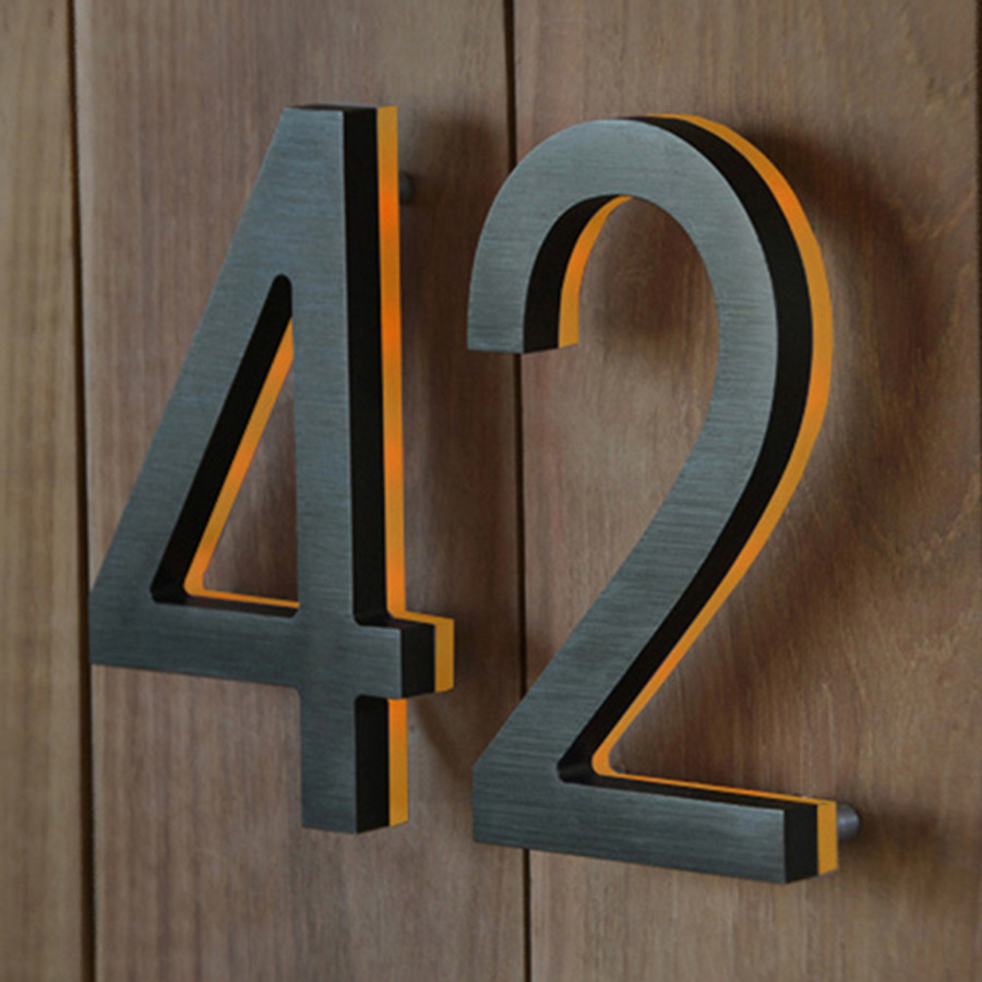 The LED Modern Bronze House Number is made from a solid piece of aluminum
