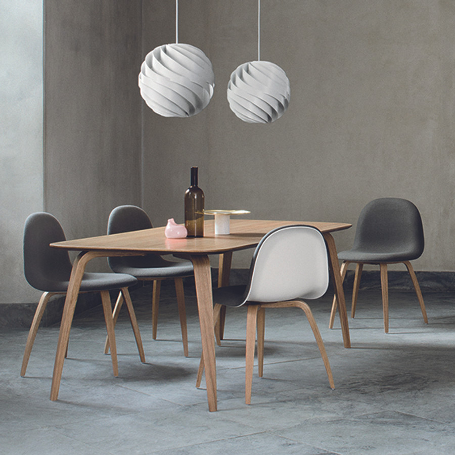 the Gubi rectangular dining table works beautifully with the iconic Gubi Chair