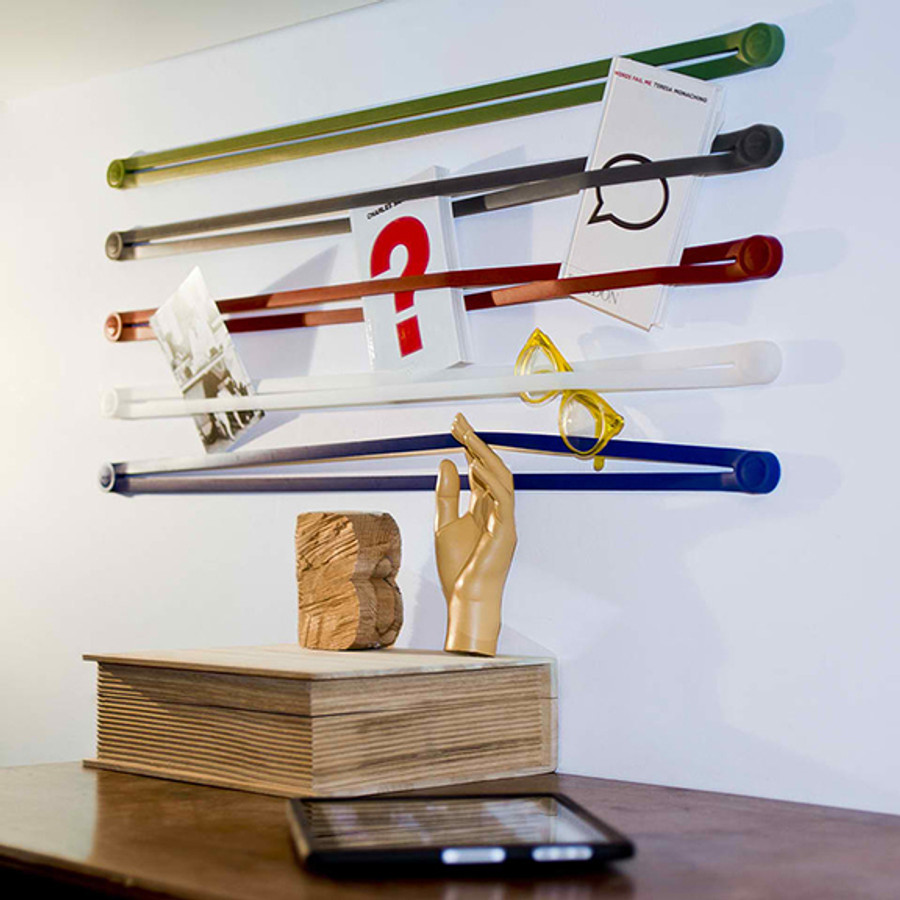 Books, magazines, toys and other objects can be stored behind these colorful rubber belts