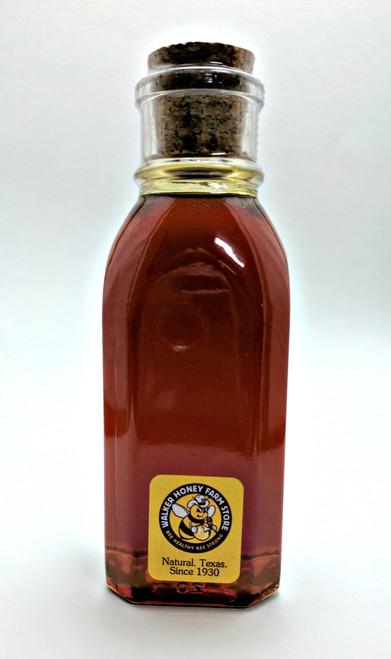 An 8 oz Muth Jar Of Sorghum Honeydew Honey.