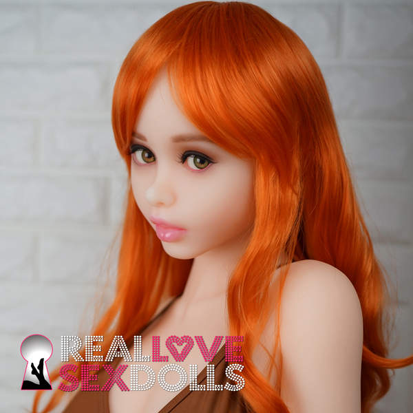 Long orange wig with curls and sexy fringe bangs for your Piper Doll.