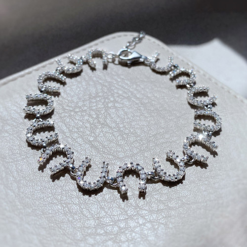 Claw Set Horseshoe Bracelet in Sterling Silver