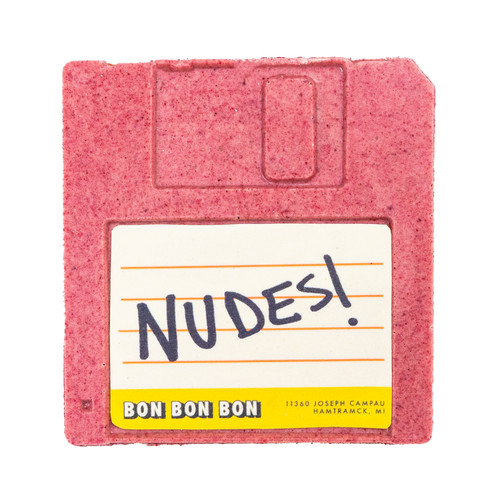 White chocolate and raspberry chocolate in the form of a floppy disk with NUDES written on it