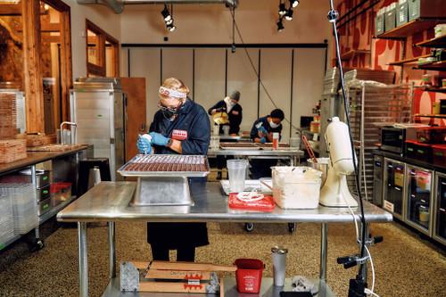 Chocolatiers making chocolate in chocolate factory in Detroit, Michigan