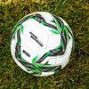 Tazmania Thermo Match Soccer Ball on Grass