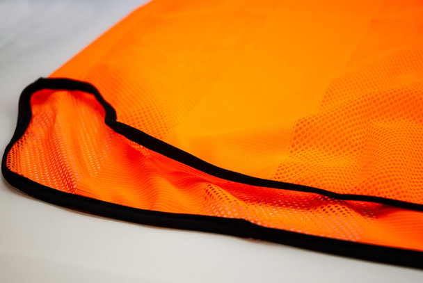 Neon orange mesh soccer training bib