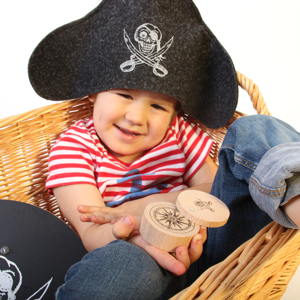 Wooden toy compass, with wool pirate hat and toy shield from Vah Spielzeug.  Made in Germany.