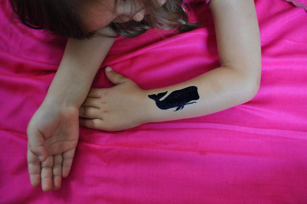 'a whale of a tale' tattoos
