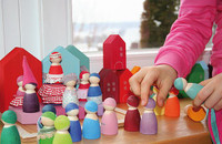 Grimm's handpainted little houses, town set up with peg dolls