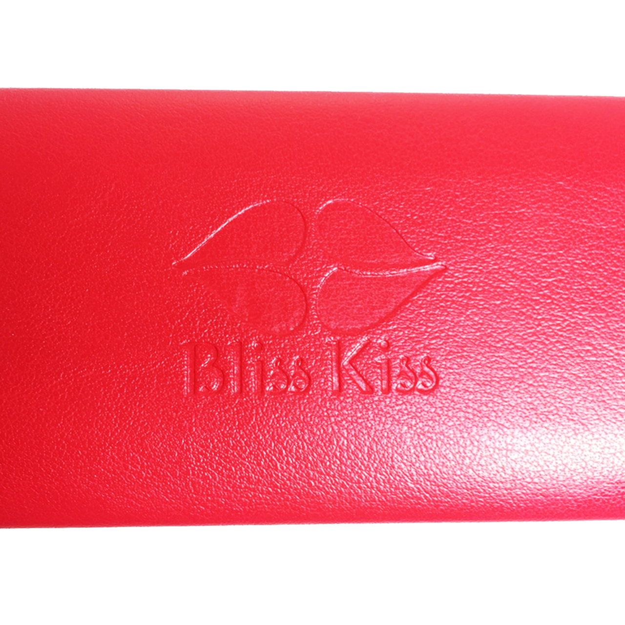"Stylish Bliss Kiss™ Carrying Case - Keep all your tools safely in one spot. Fashionable, portable, durable. Your Bliss Kiss™ Carrying Case is a gorgeous red faux leather with the Bliss Kiss™ logo embossed on top. You'll quickly wonder how you ever lived without it! Dimensions: 6"" wide x 1"" tall x 2.25"" deep."
