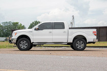 3in Ford Bolt-On Lift Kit (09-13 F-150 4WD) mounted vehicle side view