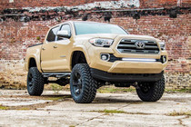 6in Toyota Suspension Lift Kit (16-20 Tacoma 4WD/2WD) front view displayed on a vehicle