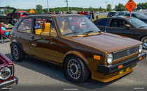"35"" X 55"" Folding Sliding Rag Top ""1974-1984 VW Rabbit"" - displayed open on a vehicle"
